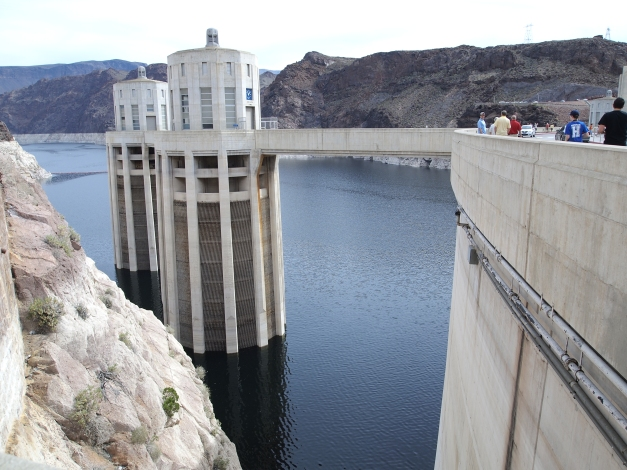 These towers collect water and send it to the turbines at the bottom of the dam. The water falls through the towers and has enough energy to spin the turbines. That rotation is used to generate electric power.